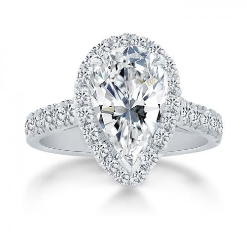Halo Set Pear Shaped Diamond Ring With Sidestones
