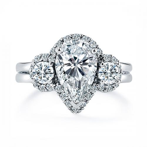 Halo Set Pear Shaped Diamond Ring With Round Brilliant