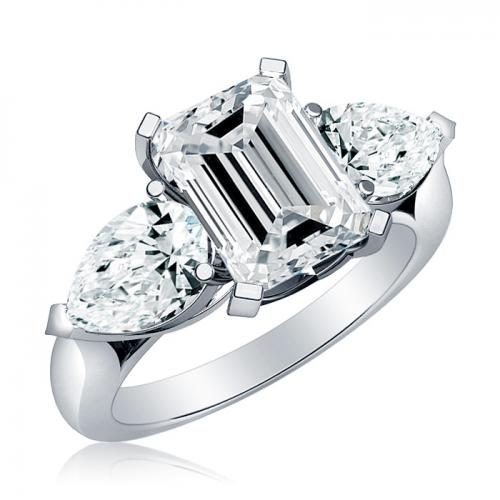 three emerald cut engagment ring with pear